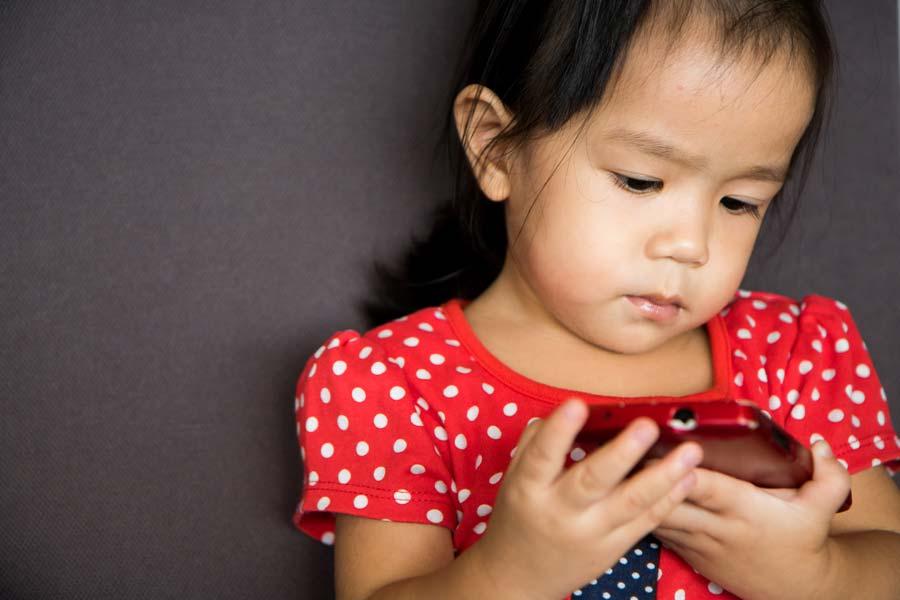 Child on smart phone